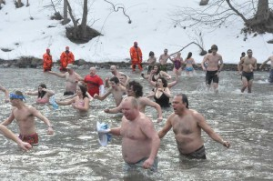 Hearty swimmers return from the west bank of the Brandywine after braving the 35-degree water.